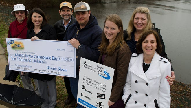 Perdue Farms' associates present a $10,000 Arthur W. Perdue Foundation grant to representatives of the Alliance for the Chesapeake Bay and Project Clean Stream. From left are Jeff Smith, Perdue director of corporate environmental services; Kim Nechay, executive director of the Arthur W. Perdue Foundation; Steve Schwalb, Perdue vice president of environmental sustainability; Tyler Wingate, Perdue environmental manager; Joanna Freeman, Project Clean Stream program manager; Laura Ricciardelli, Alliance for the Chesapeake Bay director of communications and development; and Mary-Angela Hardwick, Alliance assistant director of communications and development.