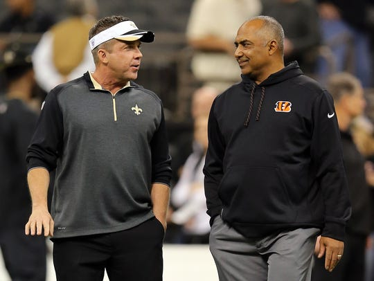 Saints head coach Sean Payton (left) talks to Bengals