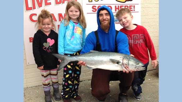 Noel Alago with his kids Alexander, Sierra, and Lacey helping to land this 10 pound bluefish.