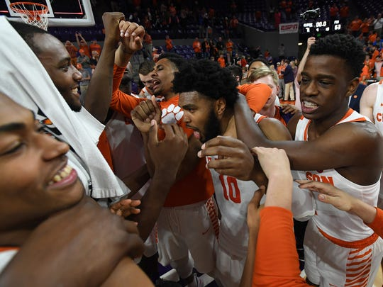 Clemson senior guard Gabe DeVoe (10), center, celebrates with his teammates after their 76-63 win over Florida State, which was his last game at Clemson's Littlejohn Coliseum,on Wednesday, February 28,  2018