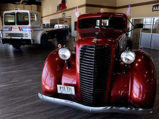 Two trucks, a 1934 Diamond T and a 1967 Trend, are