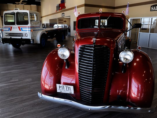 Two trucks, a 1934 Diamond T and a 1967 Trend, are parked in the showroom at Lonestar Truck Group in Abilene Wednesday Aug. 30, 2017. The dealership sells and repairs commercial trucks and opened at its West Overland Trail location at the beginning of the summer.