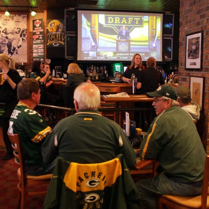 Green Bay Packers fans gather at The Clubhouse Sports Pub & Grill in downtown Appleton last year to take part in Clubhouse Live's first NFL Draft party.