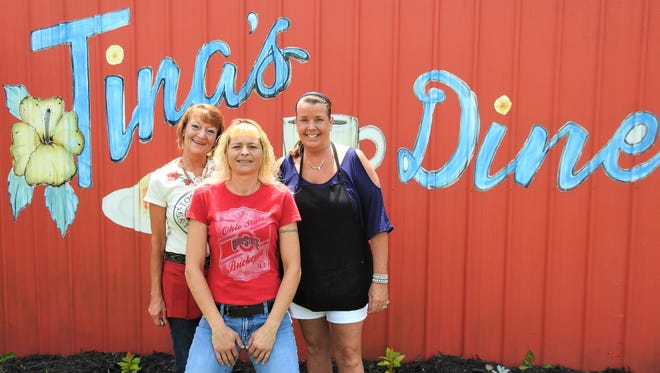 Tammy Rodgers (left), Tina Mayfield (center) and owner Tina Burkett (right) run Tina's Diner in the Roseville-Avondale area. Tina's will be celebrating 13 years in July.