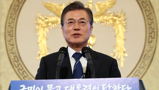 epa06147888 South Korean President Moon Jae-in is pictured speaking during a news conference at Cheong Wa Dae (Blue House) in Seoul, South Korea.