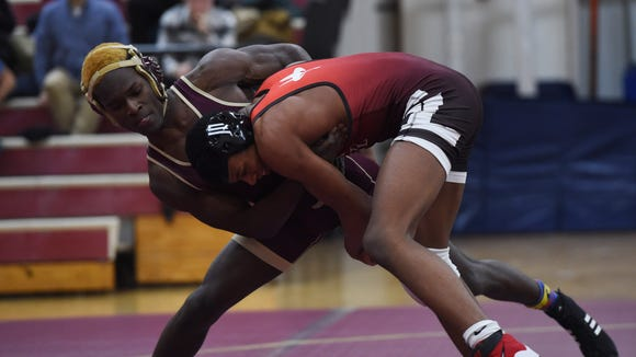 Arlington's Kawan Wills, left, wrestles Fox Lane's
