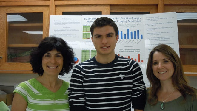 Spackenkill High School student James Hannon, center, with science teachers Amy Matts, left, and Jennifer Maloney, right, has completed research to help heart patients.