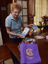 Gloria Hearn shows books donated by the Rapides Parish