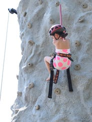 Sophia Holmes, 6, of Clayton descends after climbing