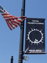 A banner advertising the solar eclipse with the signature