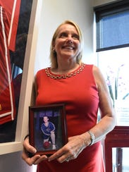 Shelly Church holds a photo of her son Kyle Fernstrom, who died 12 years ago at age 18 from a congenital heart defect.  In order to feel closer to her son, Church keeps dozens of plaques, photos and mementos of her son inside her office at Raymond James in Naples. The mom and son duo started volunteering with the American Heart Association in 1996. Church continues their work by raising money every year for the annual Collier County Heart Walk. This year, she hit her $1 million milestone of fundraising for heart disease research and awareness.