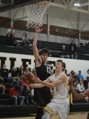 Wichita Falls Rider's Ty Caswell jumps to block the
