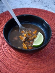 Hearty Black Bean and Chipotle Chowder is accented