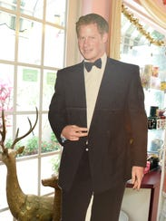 A life-sized cutout of Prince Harry greets guests inside
