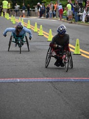 Two of the wheelchair 10K participants race to the