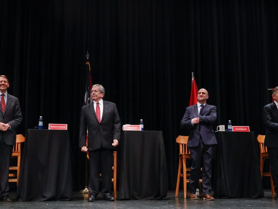 From left, Richard Cordray, former federal consumer