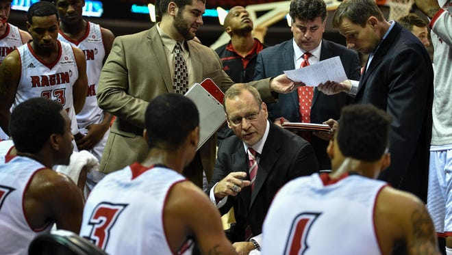 UL coach Bob Marlin talks to his team during a timeout in a December 2015 win over the University of New Orleans.