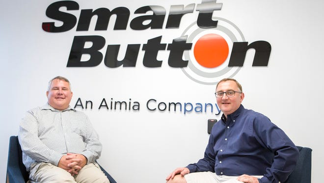 Philip Sugar (left) and James Altrichter (right) pose for a portrait at Smart Button in Newark. Launched in 1997, the tech businesses builds the software behind the loyalty rewards programs used by some of the world's largest corporations.