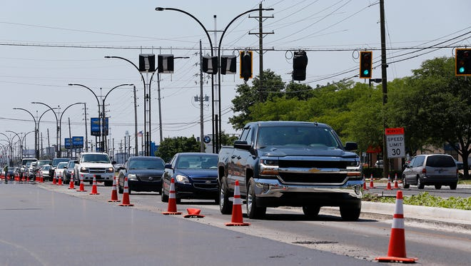 North and south traffic on Sagamore Park moves slowly through the intersection with South Street Friday, July 13, 2018, in Lafayette. East and west traffic on South Street was still closed Friday, but the intersection is scheduled to open Saturday, July 14.