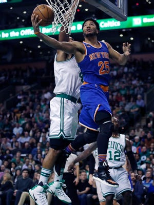 Knicks guard Derrick Rose (25) drives to the basket against the Boston Celtics during Wednesday night's game in Boston. Rose scored 30 as the Knicks defeated the Celtics 117-106.