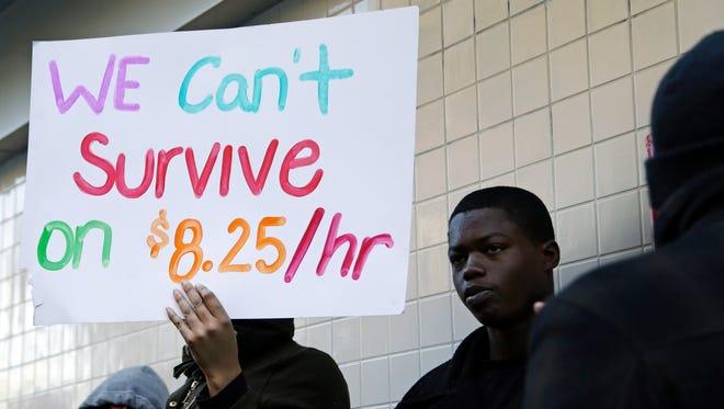 Demonstrators in favor of raising the minimum wage rally Dec. 5 in Oakland, Calif.