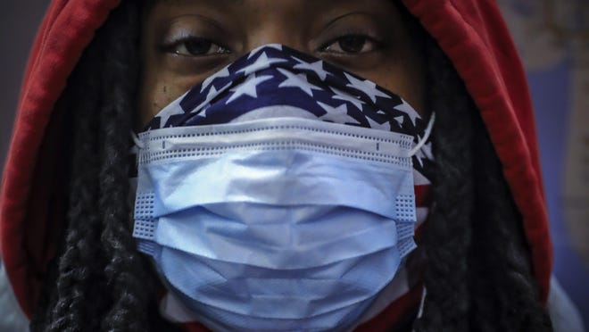 A subway rider wears a mask and a bandana to protect himself against COVID-19 in New York on April 7. As the coronavirus tightened its grip across the country, it is cutting a particularly devastating swath through an already vulnerable population, black Americans.
