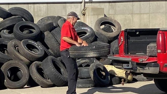 Dan Ormond, of Lincoln, disposes of his unwanted tires during the City of Lincoln's tire collection event.