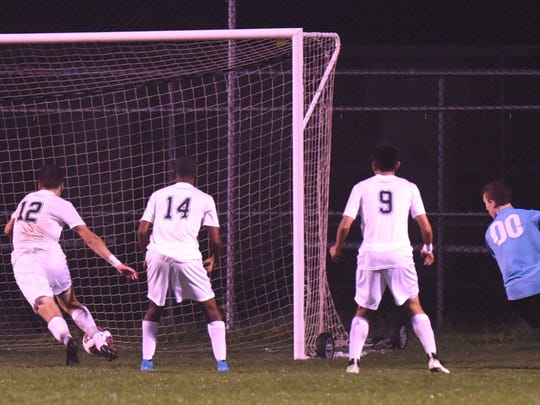 The ball slips by the Novi defense and in for the game-winning goal by East Kentwood with 9:12 remaining.