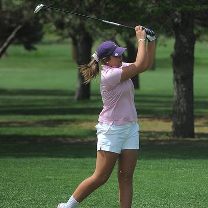 O'Gorman's Elle Carlson tees off on the fourth hole during the City Golf Meet on Monday at Elmwood Golf Course. Carlson finished two strokes behind the winner, teammate Kelsey Johnson.