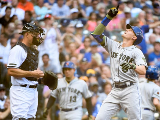 May 26, 2018; Milwaukee, WI, USA;  New York Mets center fielder Brandon Nimmo (9) reacts after hitting a solo home run in the second inning as Milwaukee Brewers catcher Erik Kratz (15) watches at Miller Park.