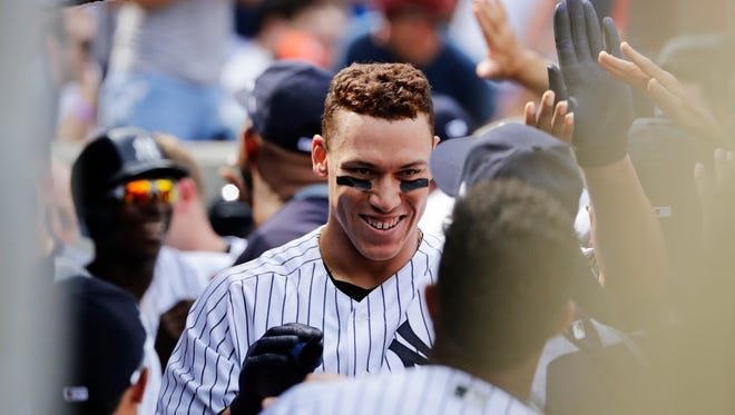 Yankees right fielder Aaron Judge celebrates with teammates after hitting a  2-run home run during the seventh inning of a baseball game against the Baltimore Orioles Saturday, April 29, 2017, in New York.