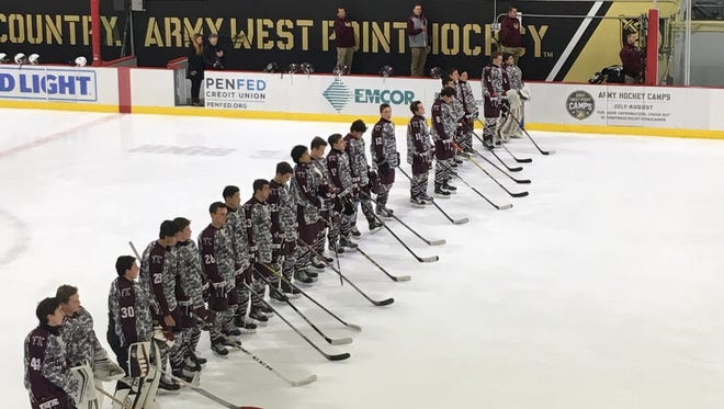 The Don Bosco hockey team lines up for the national anthem prior to its Military Appreciation Night game versus Christian Brothers at Tate Rink in West Point, N.Y., on Tuesday, Dec. 6, 2016.