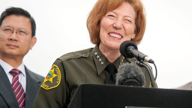 Orange County Sheriff Sandra Hutchens is all smiles as she answers questions about the capture of jail escapees Hossein Nayeri and Jonathan Tieu during a news conference outside Orange County Sheriff's Department headquarters in Santa Ana on Jan. 30, 2016.