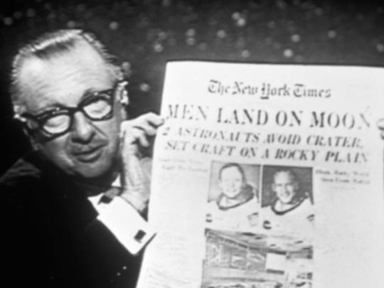 On July 21, 1969, the day after Neil Armstrong and Buzz Aldrin walked on the moon, Cronkite held up a copy of The New York Times while he was on the air. Trained as a newspaper reporter, Cronkite rejoiced anew when he saw the epoch-making story in print. (Whitehurst Photos) - Photo from the book 'CRONKITE' by Douglas Brinkley [Via MerlinFTP Drop]