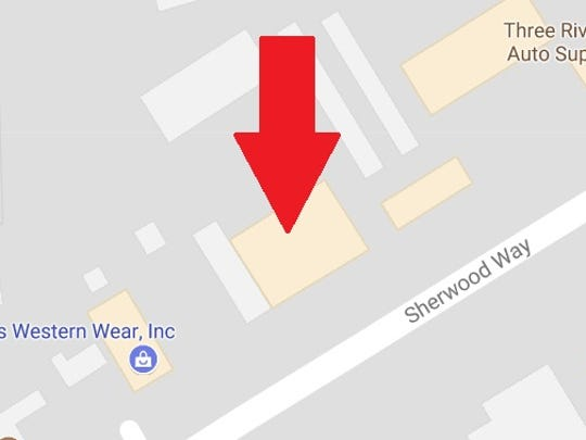 A red arrow indicates the relative position of the proposed Cotton Patch Cafe on Sherwood Way in San Angelo, according to a permit application from the city .