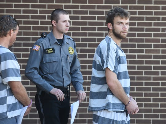 Terry Lynn Teeter Jr., right, walks out of the Baxter County Court Annex following a an earlier hearing. Teeter was sentenced to 10 years in prison Thursday in connection with a December fatal hit and run accident that took the life of 22-year-old Mountain Home resident Christopher Jordan.