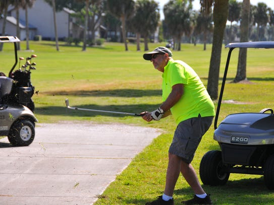 Rick Cable hits close to the rough Tuesday morning at Mallards Landing Golf Course, which is owned by the city of Melbourne.