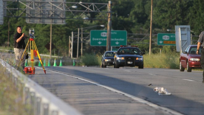 A 2010 file photo of New York State Police investigating an accident that killed a pedestrian on 590 North near Ridge Road in Irondequoit on July 26, 2010.