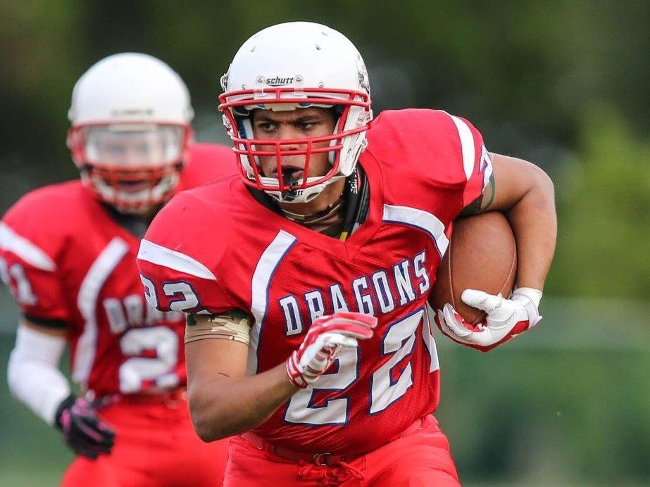 FSDB football player Anthony Wallace runs for a first down during a game against Halifax Academy early in the 2015 season. The Dragons completed their 102nd season of football two weeks ago.