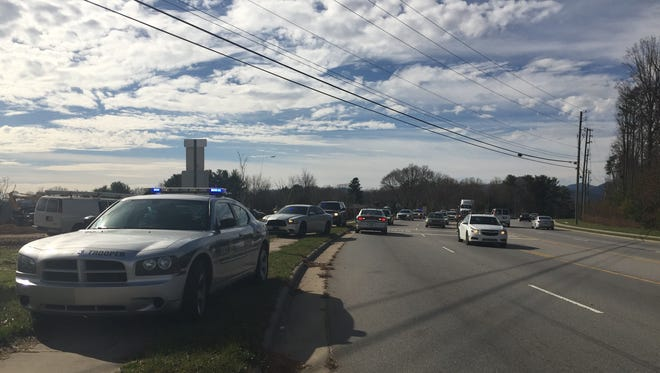 Highway Patrol vehicles are on the scene where a vehicle chase on Interstate 26 ended Wednesday afternoon at a construction site on Long Shoals Road.