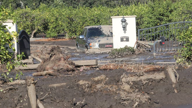 A vehicle is stuck in a driveway of a home in Montecito, January 12, 2018.
