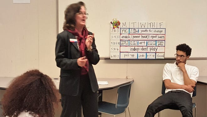 Etta Denk, senior vice president at Bank of America, spoke to youths about finances, saving for college, and budgeting during the Boys & Girls Club of Vineland Career Day at Cunningham School.