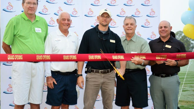 The members and staff of Pelican Sound Golf & River Club in Estero celebrated the reopening of their golf course on Oct. 4, 2016, with a ribbon-cutting ceremony. Clark Construction Group regrassed all three nines. The Sound and River courses are open for play, with the Lakes course to be ready by Nov. 1.