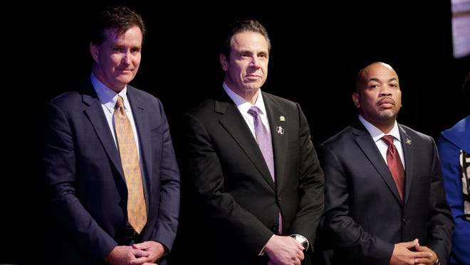 New York Gov. Andrew Cuomo, center, with Senate Majority Leader John Flanagan, left, R-Smithtown, and Assembly Speaker Carl Heastie, D-Bronx, before delivering his State of the State address and executive budget proposal at the Empire State Plaza Convention Center on Wednesday, Jan. 13, 2016, in Albany, N.Y.