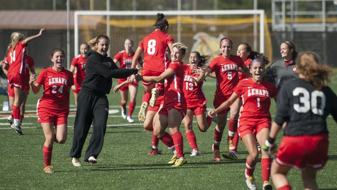 Members of the Lenape girls' soccer team celebrate after beating Washington Township in a shootout in the South Jersey Soccer Coaches Association final.