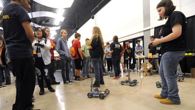 ATEMS students demonstrate their robots at the 3rd Annual World of Work Youth Expo Wednesday, Nov. 16, 2016, at the Abilene Civic Center.