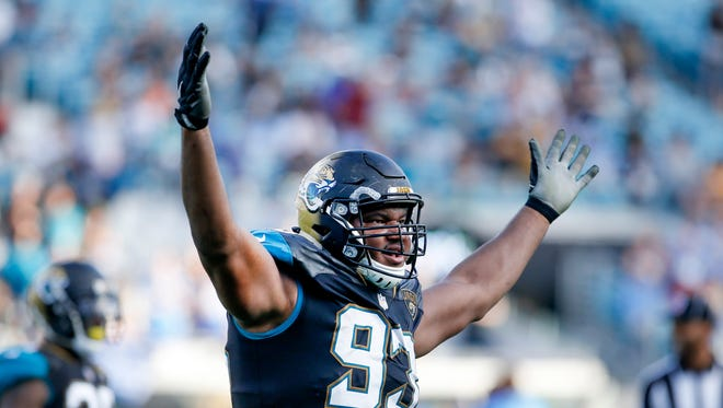 Nov 12, 2017; Jacksonville, FL, USA;  Jacksonville Jaguars defensive end Calais Campbell (93) reacts with the crowd during the second half against the Los Angeles Chargers at EverBank Field. Mandatory Credit: Reinhold Matay-USA TODAY Sports