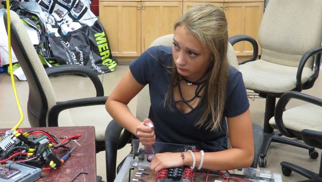 Lauren Piatti, the technological project lead of MORT 11, is working on an electrical board for the team's robot, which will compete in the Mount Olive District Competition from March 9 to 11.