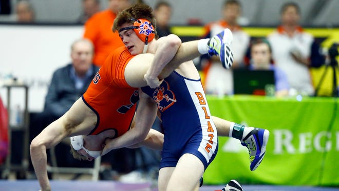 Blackman's Landon Fowler battles Summit's Sawyer Knott during the state individual tournament in February. Fowler won the 170-pound state title and is a finalist for the all-area wrestler of the year award.