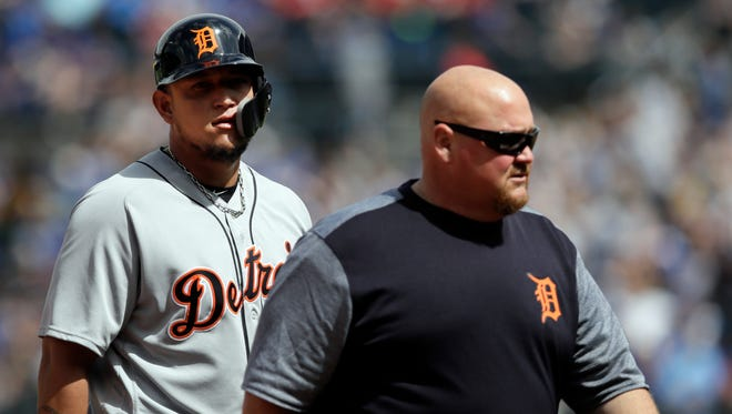 Detroit Tigers' Miguel Cabrera, left,  leaves the game with an injury accompanied by Tigers trainer Doug Teter, during the sixth inning against the Kansas City Royals in Kansas City, Mo., Thursday, May 3, 2018.